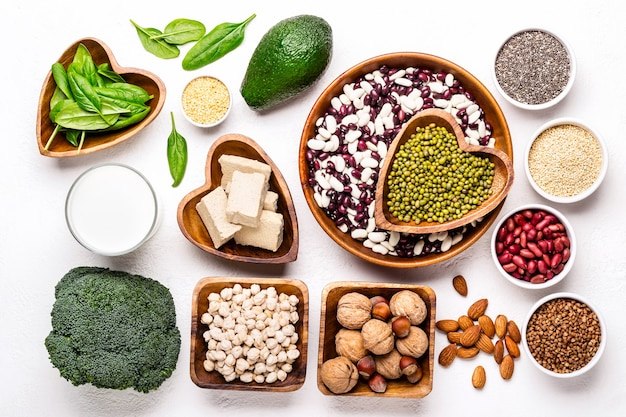 Selection of vegetable protein sources. beans, broccoli, spinach, nuts with bowls