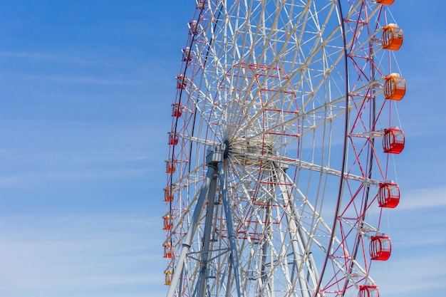 Selective focus of beautiful colorful ferris wheel and the blue sky with copy space