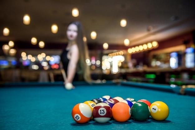 Selective focus on billiard balls triangle on table