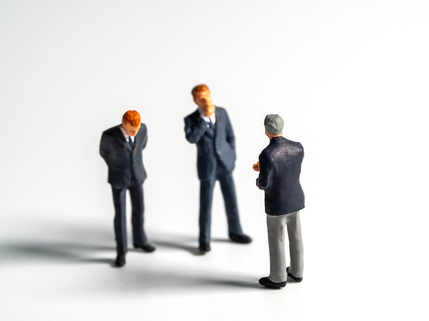 Selective focus of business figure or isolate background. the team leader discusses with the team for finding solution.