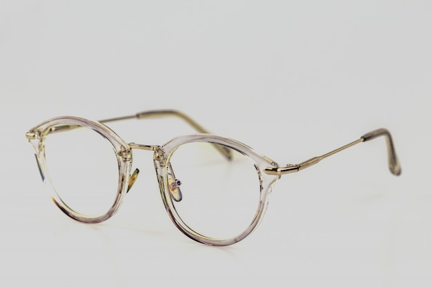 Selective focus close up eye glasses on white background.