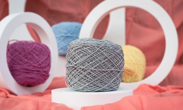 In selective focus of dull gray crochet yarn,blurry light around