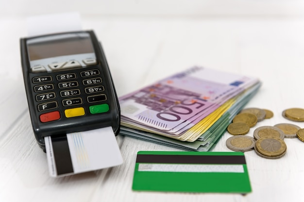 Selective focus on euro banknotes with credit card