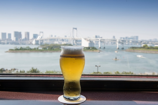 Selective focus fresh beer with tokyo bay background