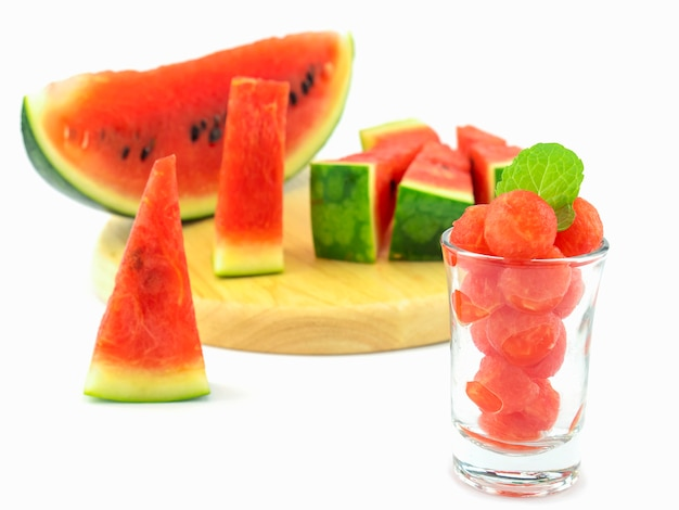 Selective focus of fresh watermelon in a glass with mint decoration