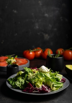 Selective focus. green salad of fresh herbs, natural food. on a dark background in a low key. a base for a light snack