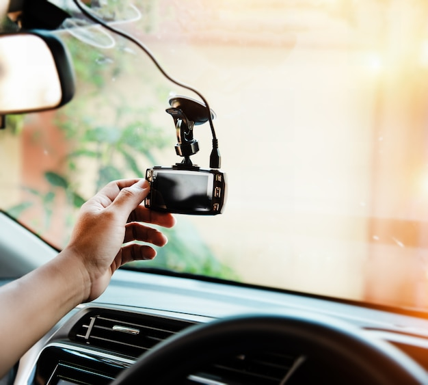 In selective focus of the human hand is touching car camera, before driving
