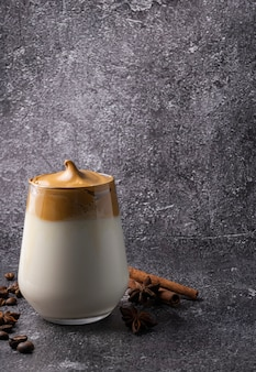 Selective focus, korean drink, dalgona coffee. with cold milk, sweet strong foam with sugar