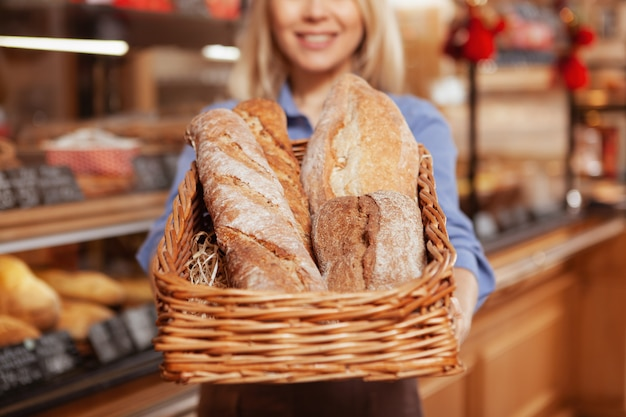 Selective focus on loafs of delicious fresh bread in a basket.