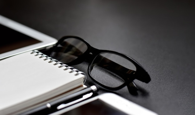 Selective focus of luxury office accessories in black and white