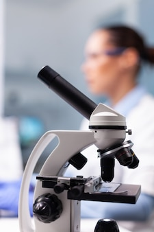 Selective focus on medical microscope standing on table in pharmacology microbiologist hospital labo...