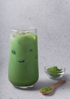 Selective focus, natural drink matcha with ice, latte with milk. tea in a tall glass