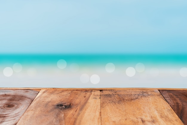 Selective focus of old wood table with blue sky for display your product.