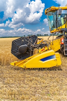 Selective focus on part of harvest gathering machine. harvest time. special technic in field.