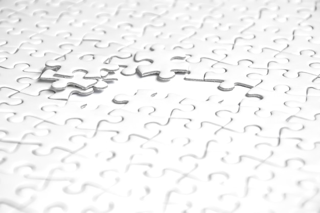 Selective focus of pieces white jigsaw puzzle, business solution concept, collaborate concept