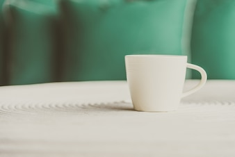 Selective focus point on black coffee in white cup - vintage filter effect