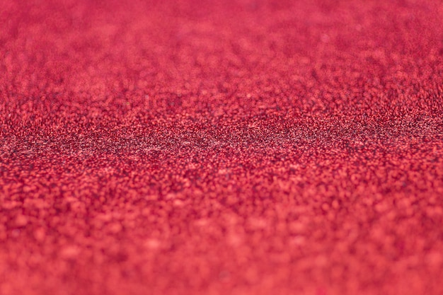 Selective focus on red glitter paper