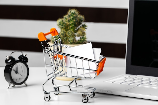Selective focus of shopping cart or trolley with blank badge paper