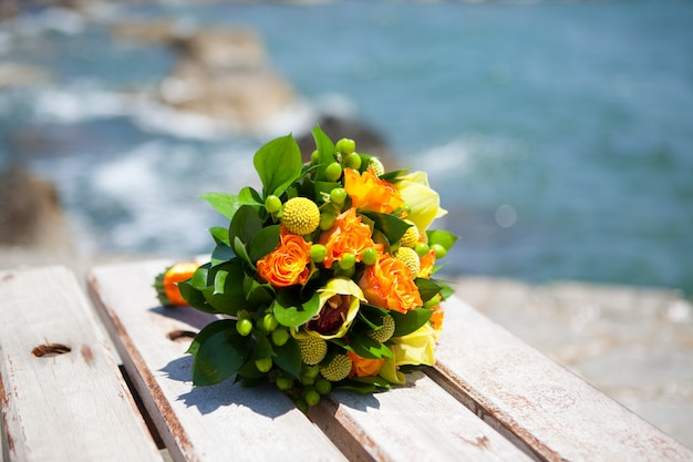 Selective focus shot of beautiful wedding bouquet on the background of the sea