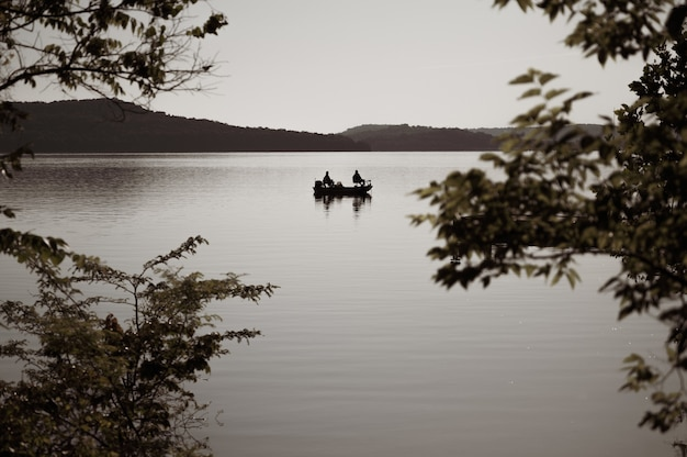 Selective focus shot of a boat on a lake in the evening