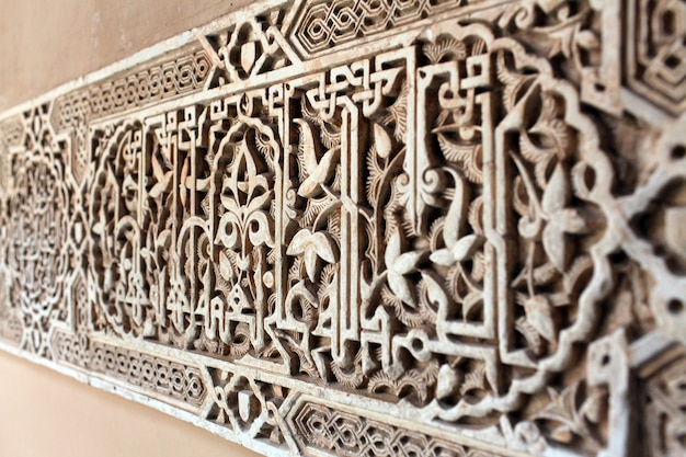 Selective focus shot of a carving of real alcazar, spain