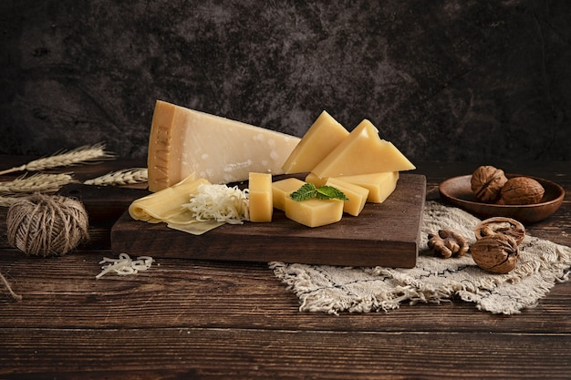Selective focus shot of a delicious cheese platter on the table with walnuts on it