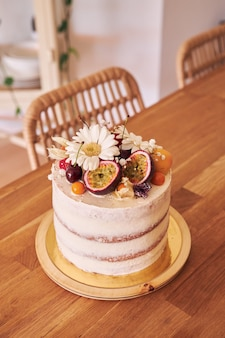 Selective focus shot of the delicious decorative cake on a brown table