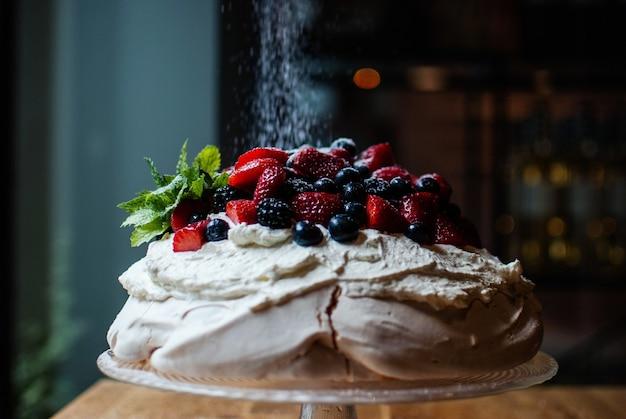 Selective focus shot of delicious dessert pavlova
