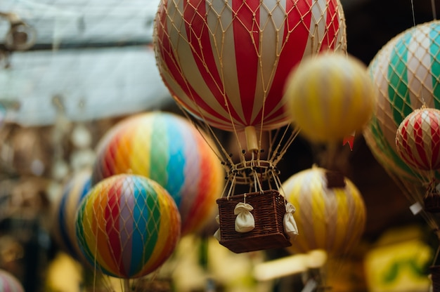 Selective focus shot of a lot of colorful air balloons