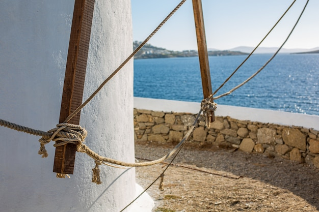 Selective focus shot of a lower part of a tower at the ocean in mykonos, greece