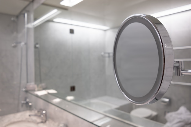 Selective focus shot of the mirror in the bathroom with white interior