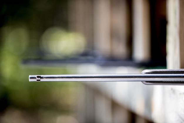 Selective focus shot of a rifle at the gun range