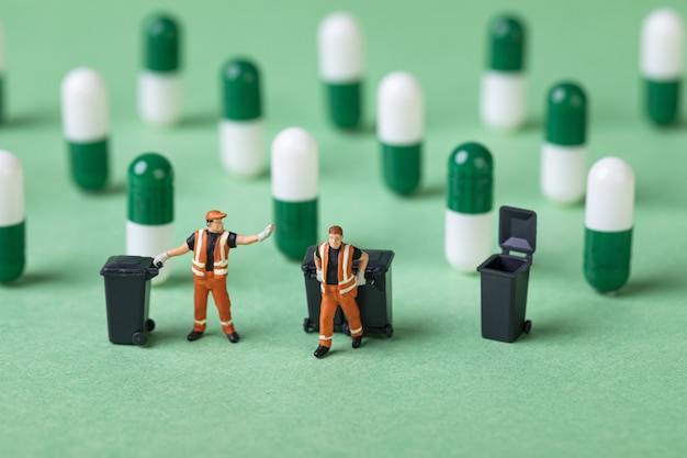 Selective focus shot of waste collector toys and capsules
