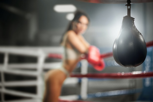 Selective focus of small punching bag.
