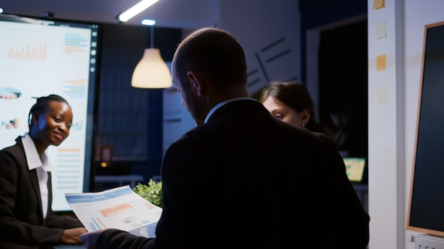 Selective focus of workaholics businesspeople brainstorming financial company ideas