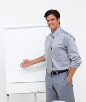 Self-assured businessman pointing at a board