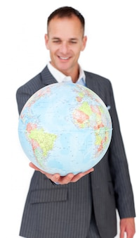 Self-assured businessman smiling at global business expansion