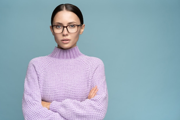 Self-assured serious business woman in sweater wear glasses