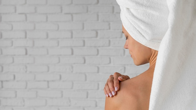 Self care concept woman wearing towel