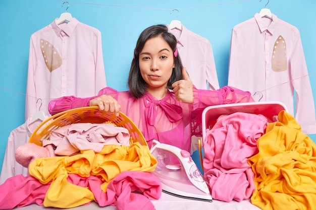 Self confident woman dry cleaner looks serious at