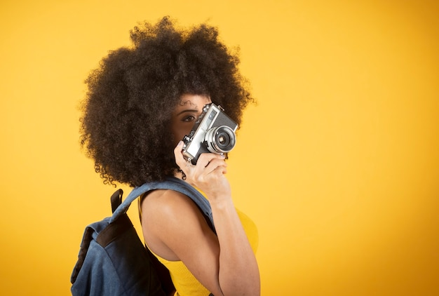 Self-portrait of a beautiful young african-american woman making a peace sign.