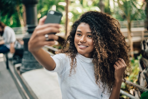 Self portrait of beautiful young woman with afro hairstyle.