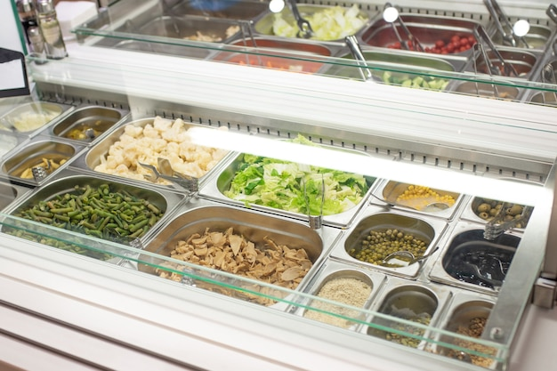 Self-service salad bar in a large store for any purpose. Premium Photo
