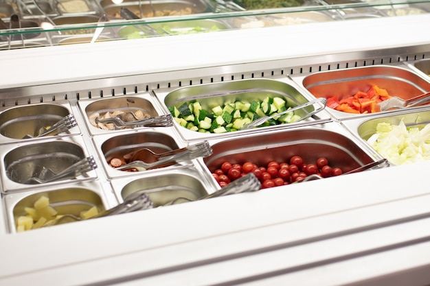 Self-service salad bar in a large store for any purpose.