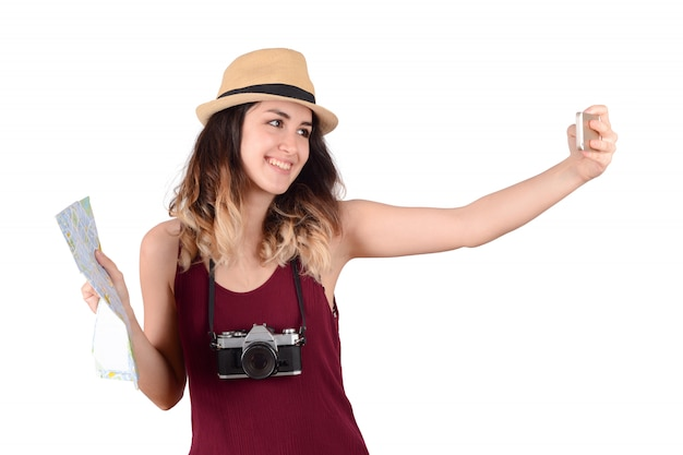 Selfieを取って若い観光客の女性。