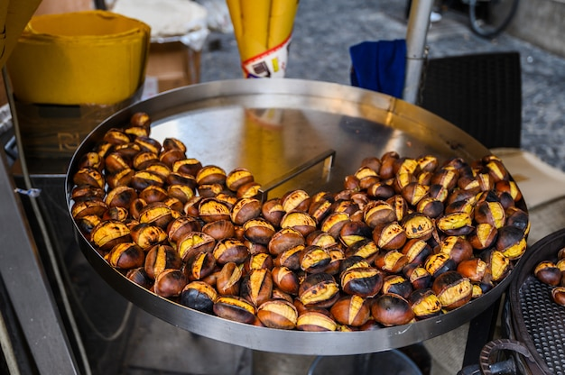 Seller of roasted chestnuts in the street