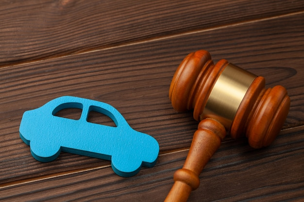 Selling or buying a car at auction. the verdict on a car accident, court. blue car and judge gavel.