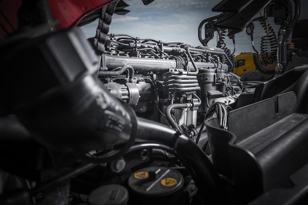 Semi truck tractor engine servicing. powerful truck engine repair.