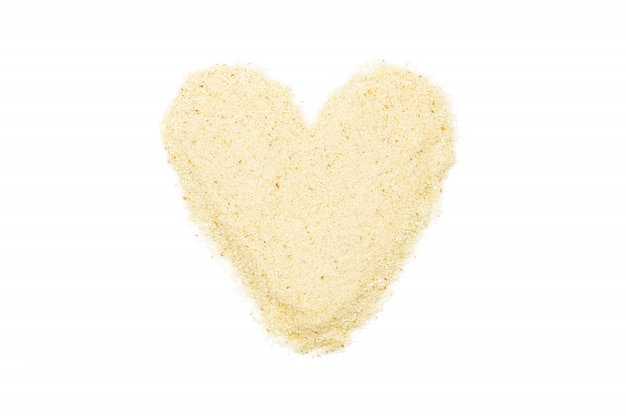 Semolina, heart-shaped, isolated, close up, macro, top view.