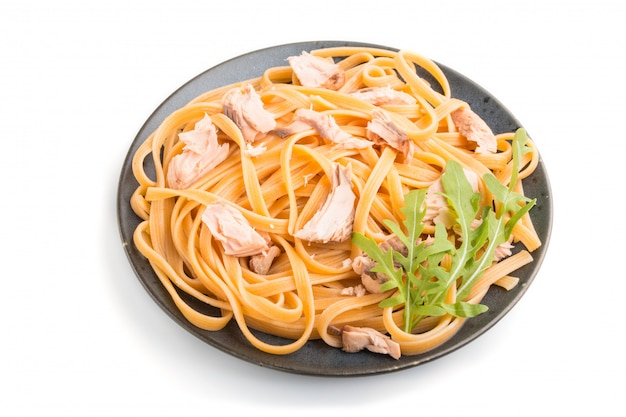 Semolina pasta with salmon isolated. side view.